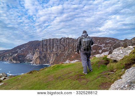 Tourist Standing At Slieve League Cliffs Which Are Among The Highest Sea Cliffs In Europe Rising 197