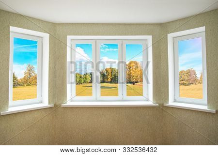 View  Through A Modern Pvc Window Onto Beautiful Autumn Landscape