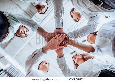 Underneath View, Business Teamwork Groups People Hands, Stacked Huddle Together, Unity International