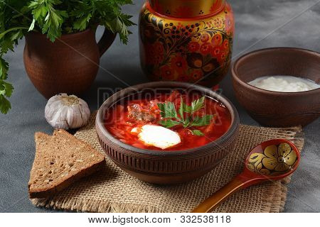 Traditional Ukrainian Russian Borscht . Bowl Of Red Beet Root Soup Borsch With White Cream . Beet Ro