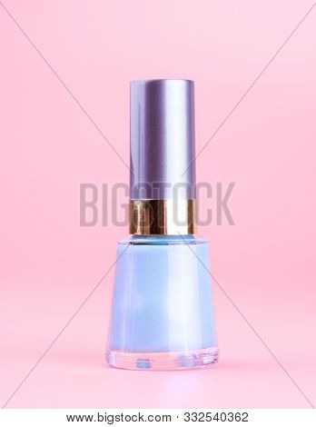 Bottle Of Nice Pearly Blue Nail Polish, Pink Background