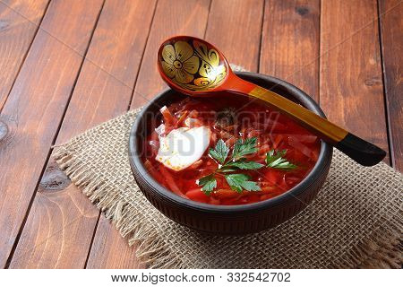 Traditional Ukrainian Russian Borscht . Bowl Of Red Beet Root Soup Borsch With White Cream . Beet Ro