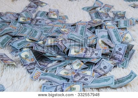 Many Banknotes Fly In The Air On A White Bed In Slow Motion. Huge Wealth Of Money, Slow Motion, Top
