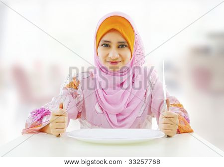 Muslim an and empty food for fork holding inside knife plate ready restaurant with woman poster