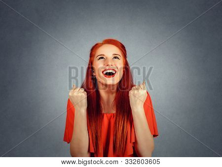 Portrait Happy Redhead Woman In Red Dress Exults Pumping Fists Ecstatic Celebrates Success Isolated
