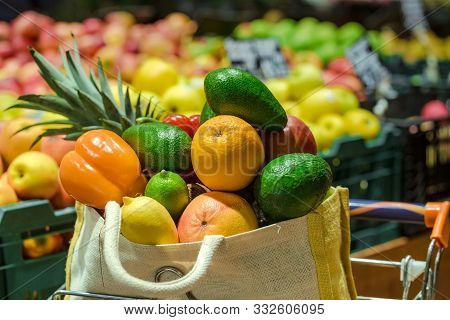 Eco Bag With Different Fruits And Vegetables. Shopping In The Supermarket.