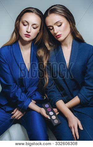 Beautiful Portrait Of Two Sisters .stock Photo
