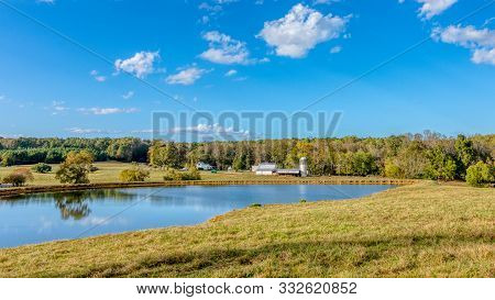 Pond With A Farm With A Barn And Silo In The Background In Orange County North Carolina