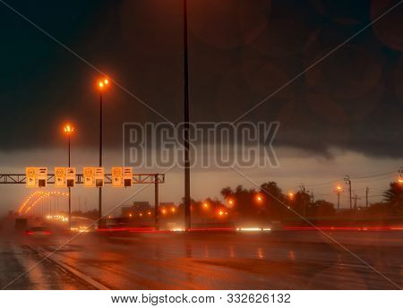 Street Light At Night In Rainy Day. Car And Truck On Asphalt Road. Dark Night At Highway With Electr