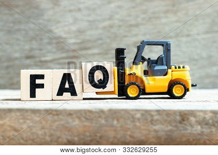 Toy Forklift Hold Letter Block Q To Complete Word Faq (abbreviation Of Frequently Asked Questions) O