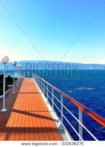 Luxury Cruise Ship Deck. Large Cruise Liner Ship Sailing Across Mediterranean Sea. Wooden Cruise Boa
