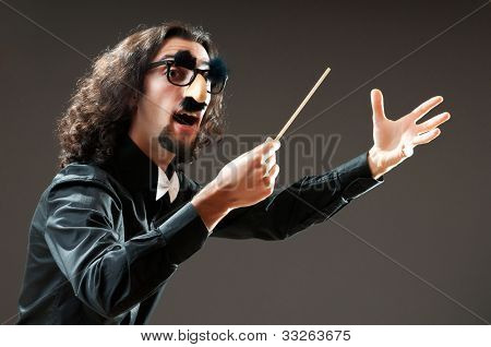 Funny conductor against dark background