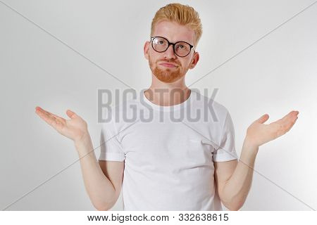 I Do Not Know What To Choose Concept, European- Looking Red Hair Man Of 30 Years With Glasses And Wh