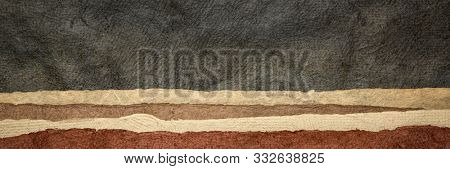 abstract landscape panorama in earth tones created with sheets of textured bark  paper handmade in Mexico