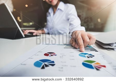 Business Accounting , Business Woman Using Tablet With Calculate Stock Maket Data Chart, Tax And Bud