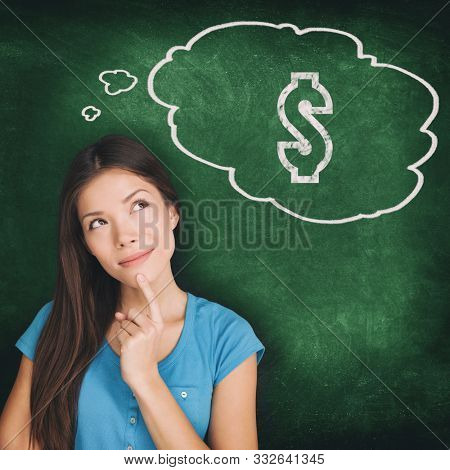 Thought bubble dollar sign drawing young Asian woman thinking of money saving budget how to make profit idea. Illustration on green chalkboard background. Black Friday or Cyber Monday sale shopping.