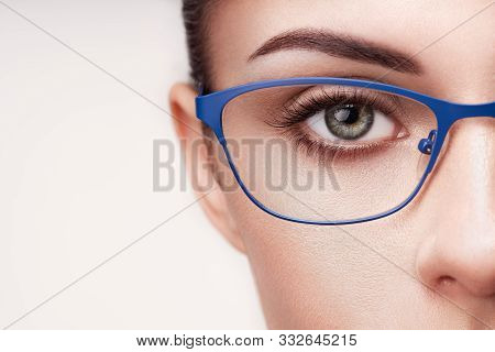 Female Eye With Long Eyelashes In Eyeglasses. Model In Glasses. Vision Correction. Poor Eyesight. Sp