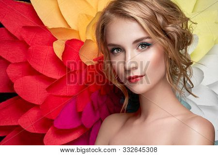 Beautiful Woman On The Background Of A Large Flower. Beauty Summer Model Girl With Rainbow Chrysanth