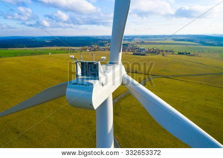 Wind turbine in Western Bohemia. Power plant with 2.0 MW output. Sustainable development and electricity in Czech Republic. Aerial view to windmill.