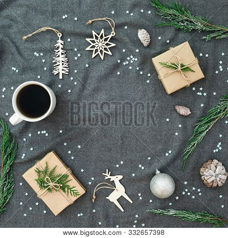 Christmas Decorations, Evergreen Tree, Snowflakes, Coffee Cup And Gifts On Gray Plaid. Flat Lay, Top