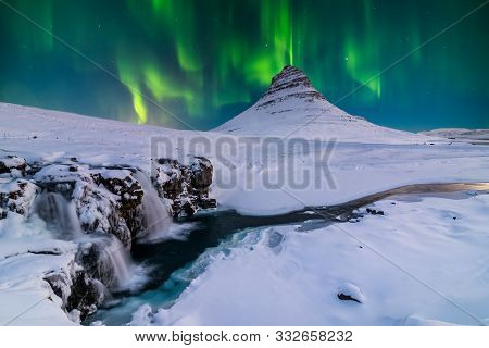 Northern Light, Aurora Borealis At Kirkjufell In Iceland.
