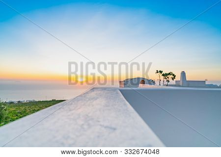 Defocused Effect Of Early Morning View Along Parapet Top Surface Into Horizon And Santorini Sunrise