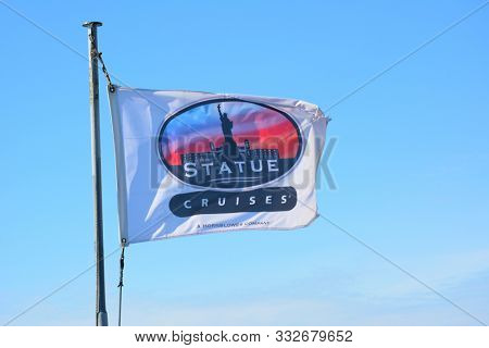 JERSEY CITY, NEW JERSEY - 04 NOV 2019: Statue Cruises flag atop the Miss Ellis Island, a ferry service that provides the only tourist transportation to The Statue of Liberty and Ellis Island.