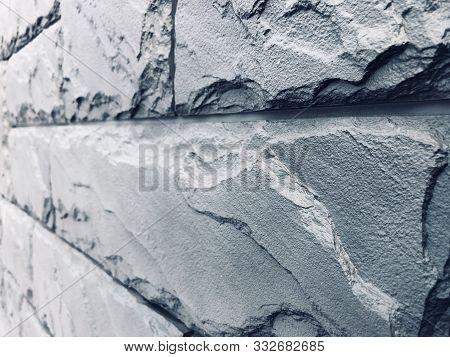 Stone Blue-gray Wall, Masonry Of Large Untreated Cobblestones With Seams