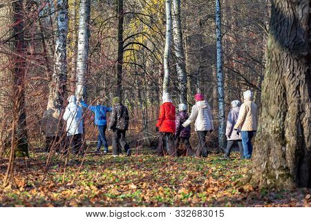 St. Petersburg, Russia - November 07,  2019: Health Group Of Elderly Women With A Trainer Walking In