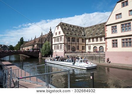Tourists On A Boat On A Sightseeing Cruise On The Canals Of Historic Strasbourg