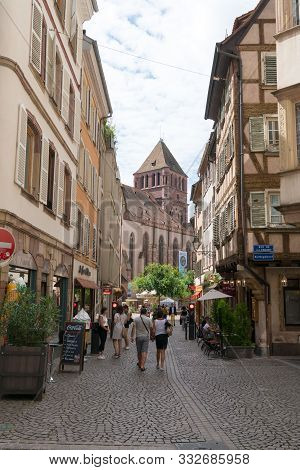 The Busy Streets In The Historic Old Town Of Strasbourg Filled With Tourists In High Summer