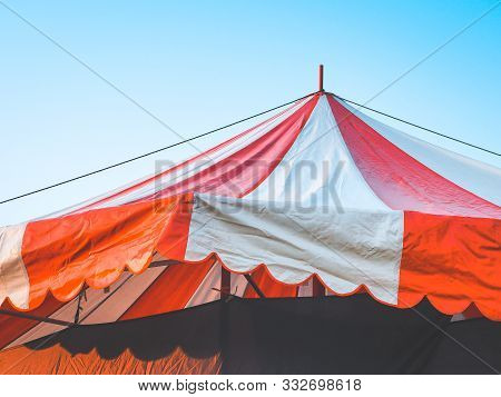 Close Up Of Red Big Top Carnival Tents Or Circus Striped Tent. Vintage Tent For Entertainment Funfai