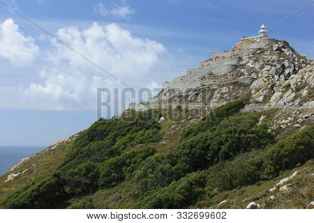 Cies Islands Lighthouse Located On A Mountain. Pontevedra - Spain