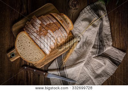 Sliced Loaf Of Bread On A Chopping Board. Small Depth Of Field.