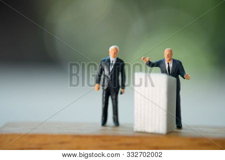 Miniature People : A Politician Speaking To The People During An Election Rally