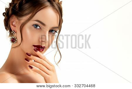 Beautiful Model Girl With Burgundy Or Wine Color Manicure On Nails . Fashion Makeup And Cosmetics .