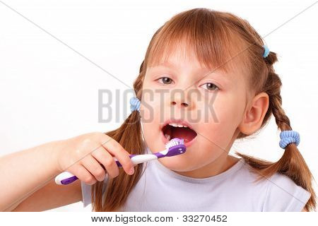 Little Girl Brushes Her Teeth