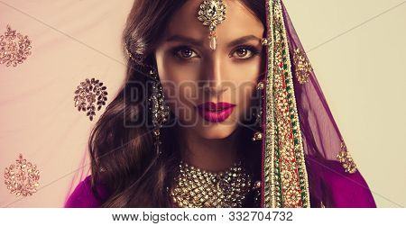 Portrait Of Beautiful Indian Girl . Young Hindu Woman Model  In Sari And  Kundan Jewelry . Tradition