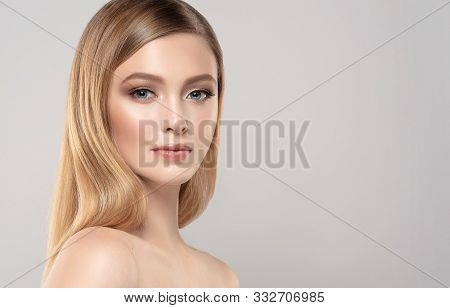 Beautiful Young Woman With Clean Fresh Skin On Face . Girl Facial  Treatment   . Cosmetology , Beaut