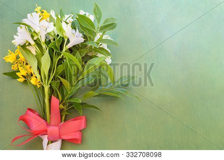 Close Up Of Alstroemeria Flowers On The Wooden Background.