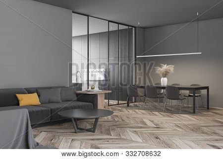 Corner Of Modern Living Room With Gray Walls, Wooden Floor, Comfortable Gray Sofa With Round Coffee