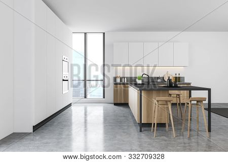 Side View Of White Kitchen With Wooden Bar