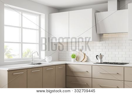 White And Beige Kitchen Corner With Countertops