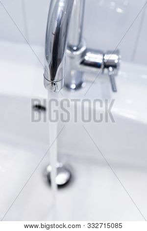 Saving Water: Close Up Of Spigot With Clear, Flowing Water