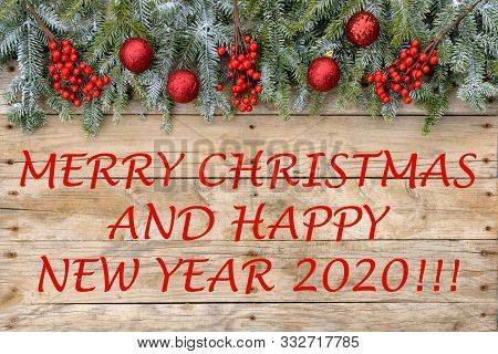 Christmas Postcard Frame 2020. Fir Tree With Red Glitter Balls And Berries On Rough Wooden Backgroun