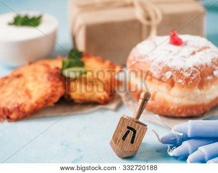 Jewish Holiday Hanukkah Concept And Background. Hanukkah Food Doughnuts And Potatoes Pancakes Latkes