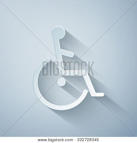 Paper Cut Disabled Handicap Icon Isolated On Grey Background. Wheelchair Handicap Sign. Paper Art St