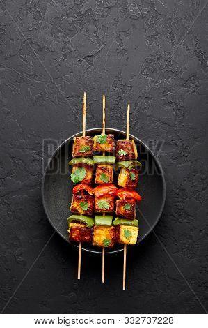 Paneer Tikka At Skewers In Black Bowl At Dark Slate Background. Paneer Tikka Is An Indian Cuisine Di