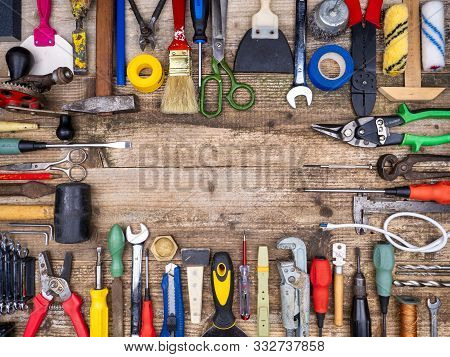 Construction Tool On A Wooden Background. A Lot Of. Background Mode. Shooting From Above. Frame.