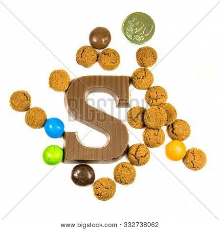 Group Of Pepernoten Strooigoed With Chocolate Letter S, Top View On White Background For Annual Sint